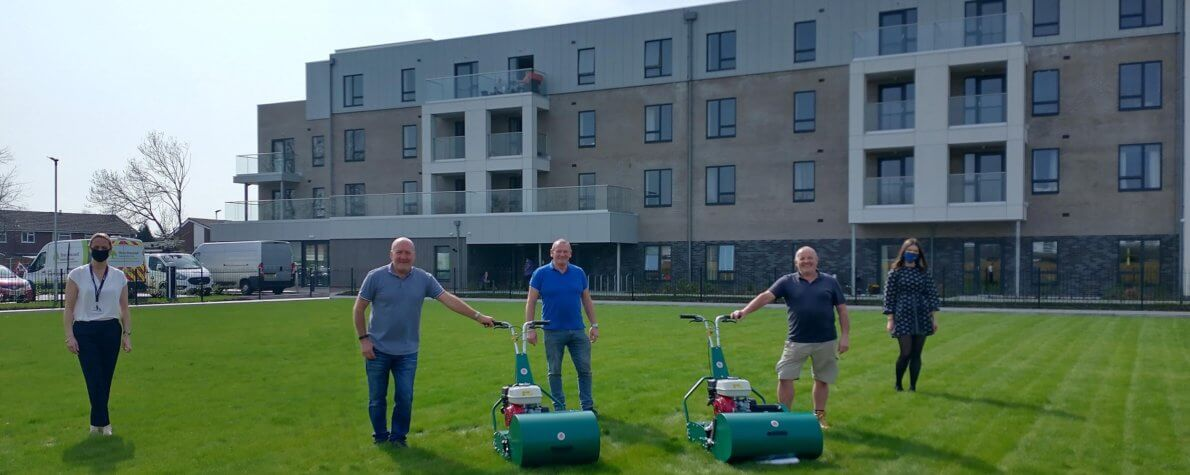 Handover of mower and scarifier at Harpers Rd, Warrington